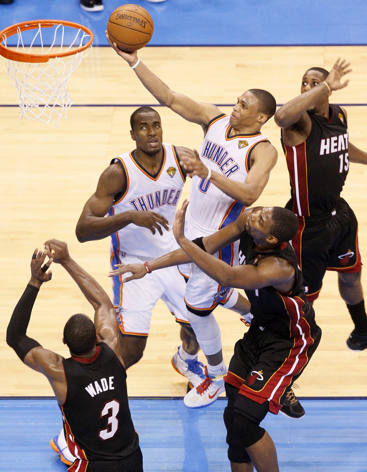 Photo - Oklahoma City's Russell Westbrook (0) takes the ball to the hoop against Miami's Chris Bosh (1), middle, Dwyane Wade (3) and Mario Chalmers (15) as Oklahoma City's Serge Ibaka (9) looks on in the fourth quarter during Game 2 of the NBA Finals between the Oklahoma City Thunder and the Miami Heat at Chesapeake Energy Arena in Oklahoma City, Thursday, June 14, 2012. Miami won, 100-96. Photo by Nate Billings, The Oklahoman