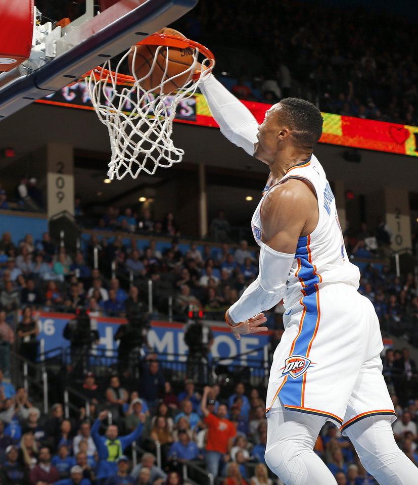 Photo - Oklahoma City's Russell Westbrook (0) dunks the ball during an NBA basketball game between the Oklahoma City Thunder and the Minnesota Timberwolves at Chesapeake Energy Arena in Oklahoma City, Sunday, Oct. 22, 2017. Photo by Nate Billings, The Oklahoman