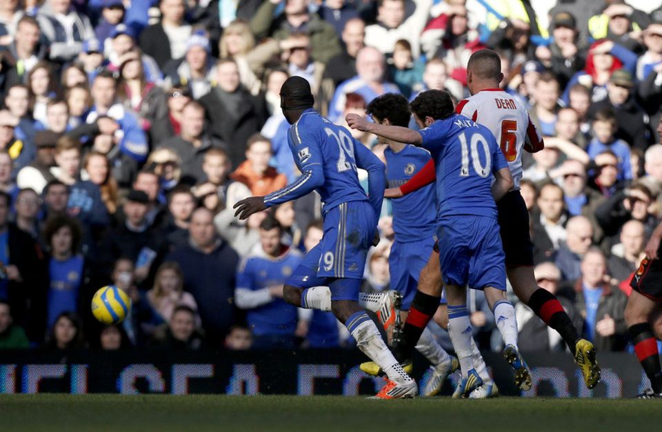 Chelsea's Juan Mata, second right, scores during the English FA Cup fourth round replay soccer match between Chelsea and Brentford at Stamford Bridge stadium in London, Sunday, Feb. 17, 2013.  (AP Photo/Matt Dunham)