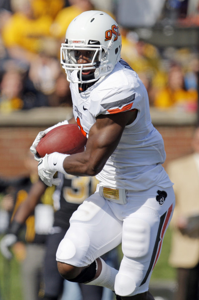 Photo - Oklahoma State's Joseph Randle (1) makes a catch for a touchdown in the second quarter during a college football game between the Oklahoma State University Cowboys (OSU) and the University of Missouri Tigers (Mizzou) at Faurot Field in Columbia, Mo., Saturday, Oct. 22, 2011. Photo by Nate Billings, The Oklahoman