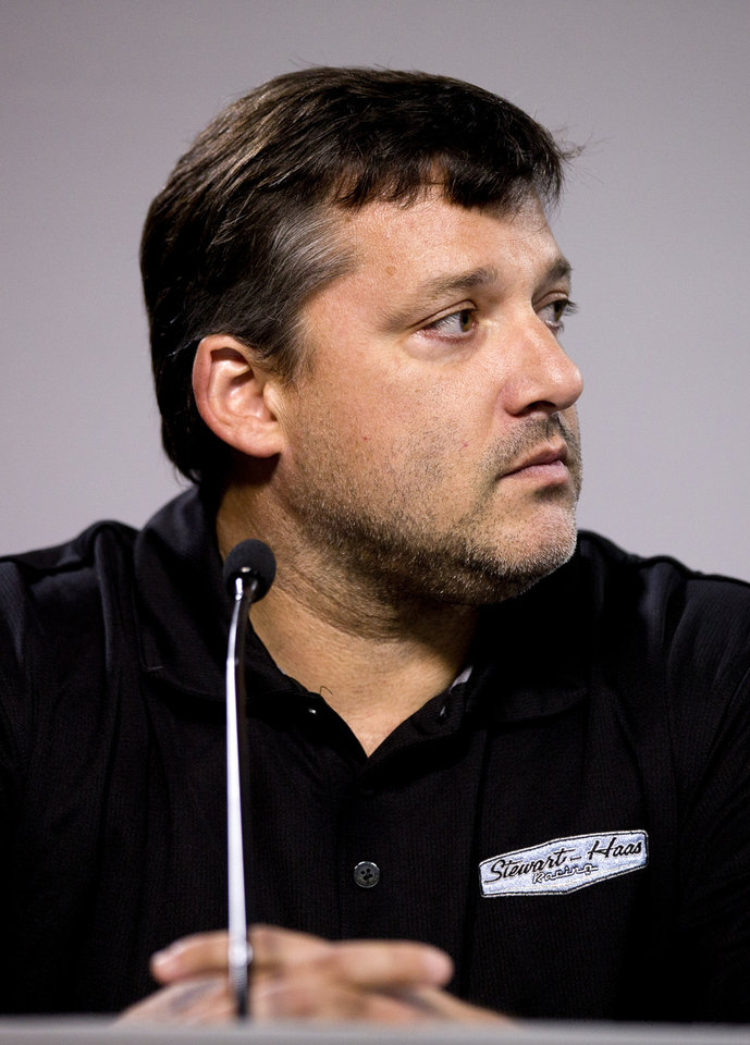 Photo - NASCAR auto racing driver Tony Stewart reads a statement during a news conference at Atlanta Motor Speedway in Hampton, Ga., Friday, Aug. 29, 2014. Stewart says the death of Kevin Ward Jr. will