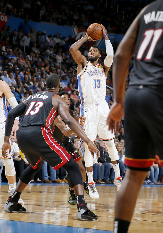 Photo - Oklahoma City's Paul George (13) attempts a shot during an NBA basketball game between the Oklahoma City Thunder and the Miami Heat at Chesapeake Energy Arena in Oklahoma City, Monday, March 18, 2019. Photo by Bryan Terry, The Oklahoman