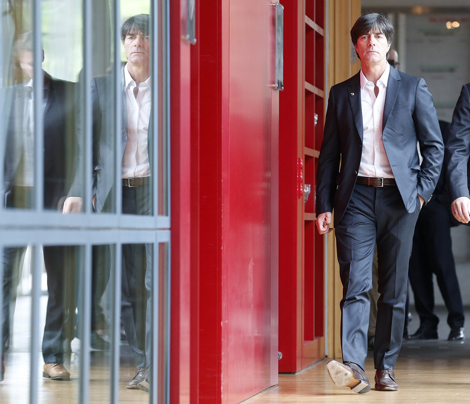 Photo - Coach of German national soccer team Joachim Loew is on his way to a press conference where he will present his preliminary team for the upcoming World Cup in Brazil in Frankfurt, Germany, Thursday, May 8, 2014. (AP Photo/Michael Probst)