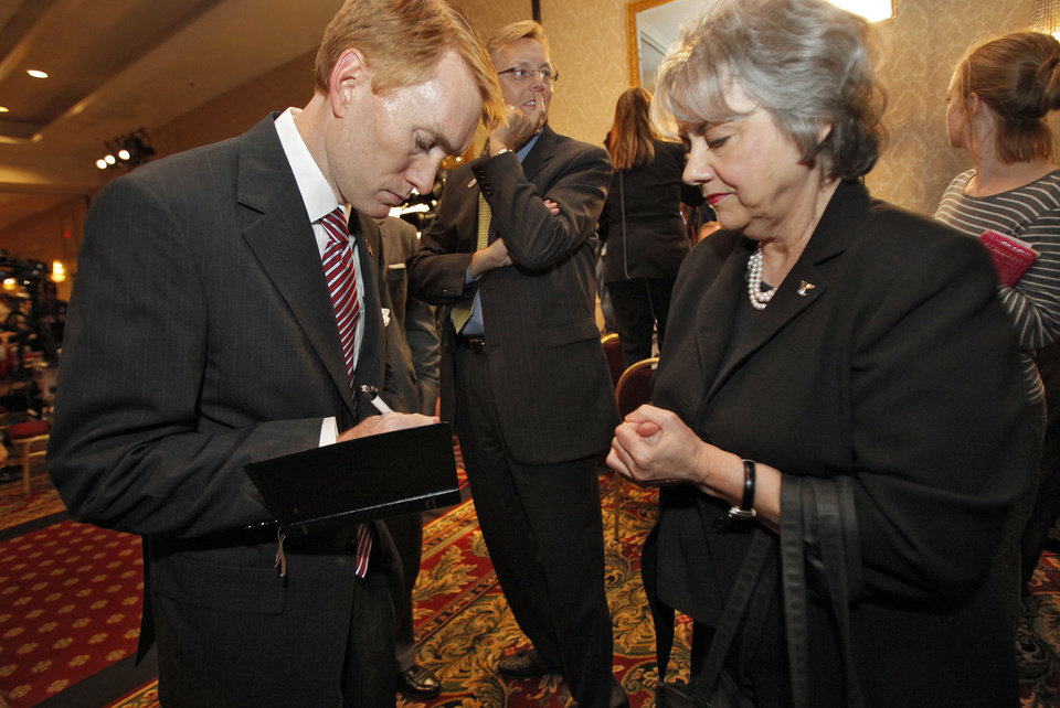 Photo - James Lankford signs an autograph for a supporter at the republican Watch Party at the Marriott on Tuesday, Nov. 2, 2010, in Oklahoma City, Okla.   Photo by Chris Landsberger, The Oklahoman