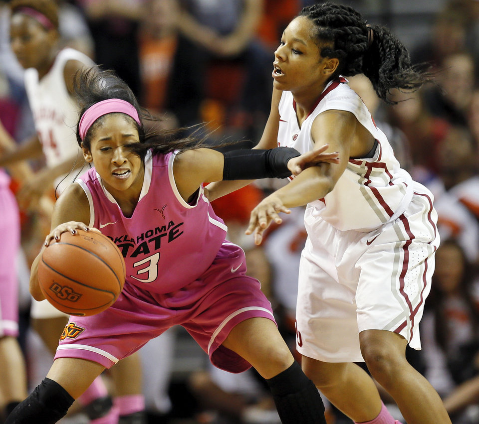 Photo - Oklahoma State's Tiffany Bias (3) keeps the ball away from Oklahoma's Gioya Carter (25) in the second half during the women's Bedlam college basketball game between the OU Sooners and the OSU Cowgirls at Gallagher-Iba Arena in Stillwater, Okla., Sunday, Feb. 16, 2014. OSU won, 73-57. Photo by Nate Billings, The Oklahoman