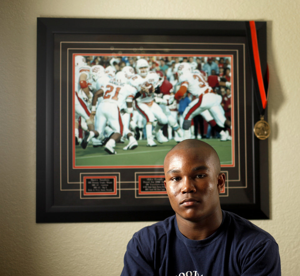 Photo - Heritage Hall's Barry Sanders in his bedroom in Oklahoma City, Saturday, Feb. 12, 2011.  Photo by Bryan Terry, The Oklahoman