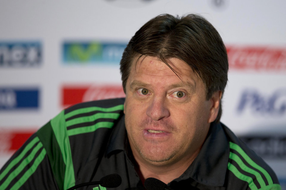 Photo - Mexico's coach Miguel Herrera talks to the press before a training session in Santos, Brazil, Friday, June 20, 2014. Mexico plays in group A at the 2014 soccer World Cup. (AP Photo/Eduardo Verdugo)