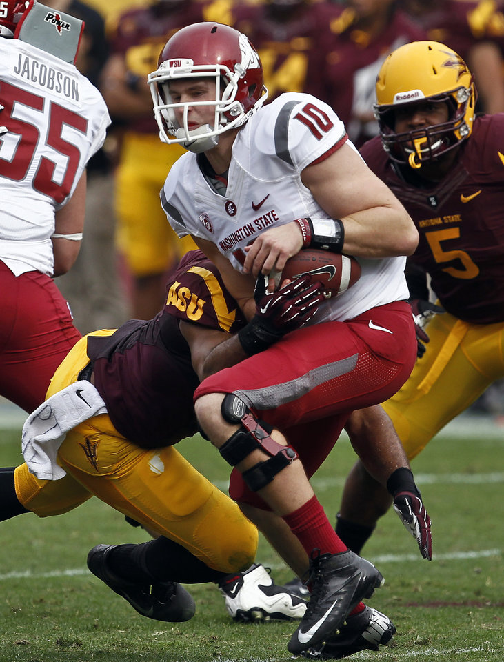 Photo -   Washington State's Jeff Tuel (10) is sacked by Arizona State's Brandon Magee, left, as teammate Junior Onyeali (5) watches during the first half in an NCAA college football game Saturday, Nov. 17, 2012, in Tempe, Ariz. Arizona State defeated the Washington State 46-7. (AP Photo/Ross D. Franklin)