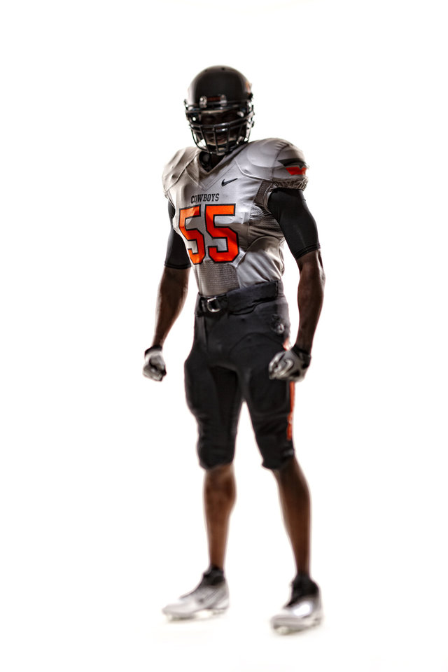 Photo - Oklahoma State's new uniforms. Pictured here is the black pants, silver jersey and black helmet. PHOTO PROVIDED