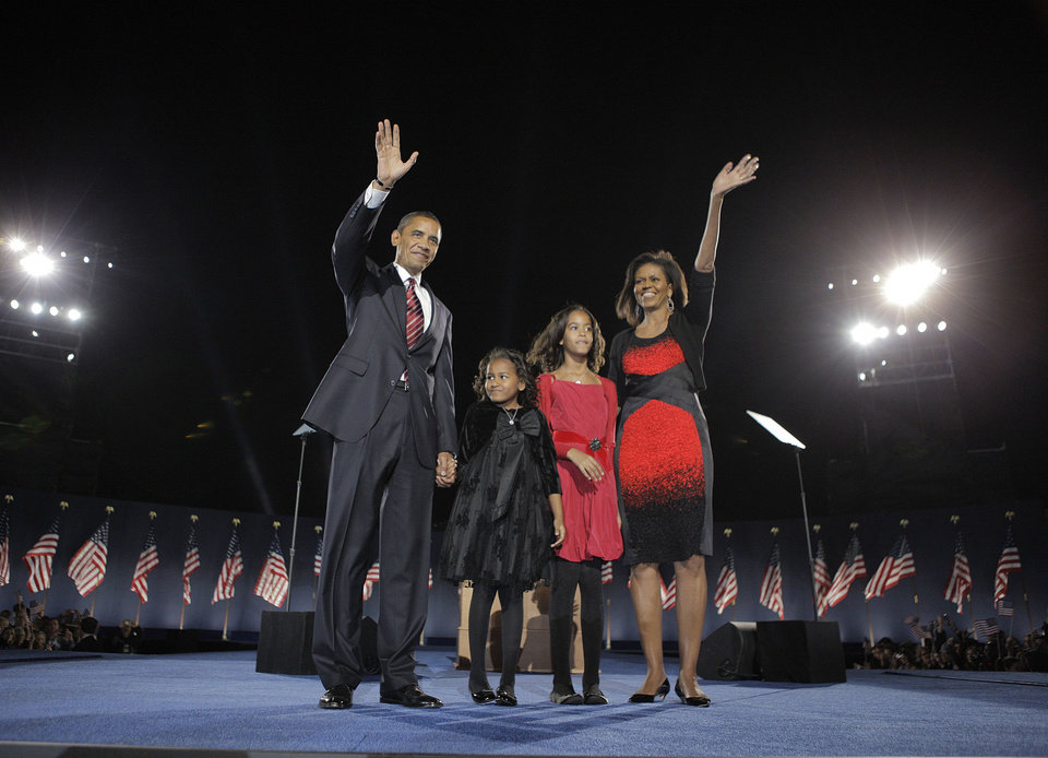 Photo - FILE-   This Nov. 4, 2008 file photo shows President-elect Barack Obama, left, his wife Michelle Obama, right, and two daughters, Sasha, 7, and Malia, 10, second from right, as they wave at the election night rally in Chicago. Sony Electronics and the Nielsen television research company collaborated on a survey ranking TV's most memorable moments. Other TV events include, the Sept. 11 attacks in 2001, Hurricane Katrina in 2005, the O.J. Simpson murder trial verdict in 1995 and the death of Osama bin Laden in 2011.  (AP Photo/Jae C. Hong, File) ORG XMIT: NYET130