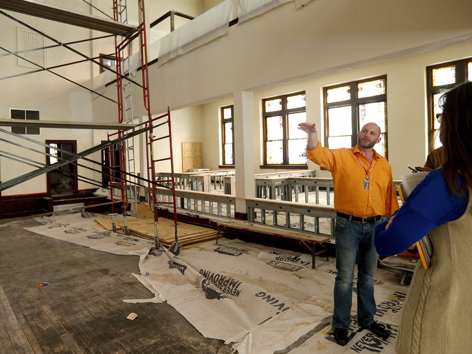 Photo - J.W. Peters points to renovations inside the Calvary Baptist Church in the Deep Deuce district of downtown Oklahoma City, Wednesday, Feb. 14, 2013. Photo by Bryan Terry, The Oklahoman