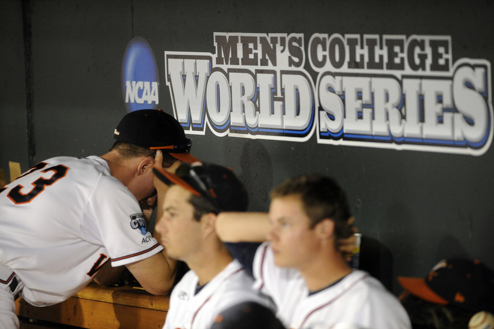 Photo - Virginia players react to the team's 3-2 loss to Vanderbilt in the deciding game the best-of-three NCAA baseball College World Series finals in Omaha, Neb., Wednesday, June 25, 2014. (AP Photo/Eric Francis)