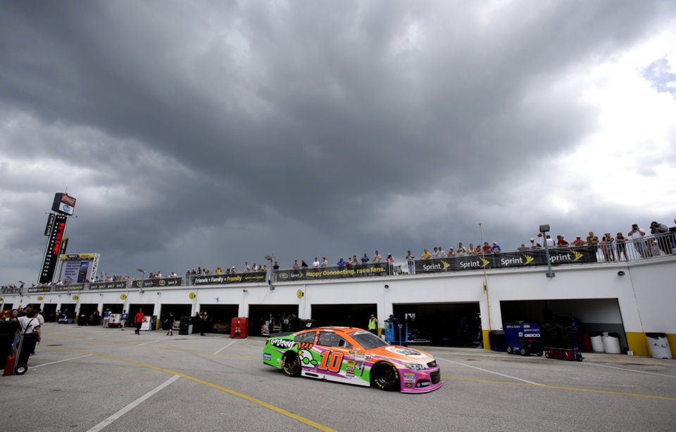 Photo - Danica Patrick (10) drives out to the track just before a weather delay stopped a NASCAR Sprint Cup practice session at Daytona International Speedway in Daytona Beach, Fla., Thursday, July 3, 2014. (AP Photo/John Raoux)