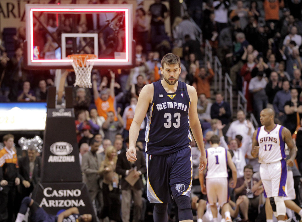 Photo - Memphis Grizzlies' Marc Gasol, of Spain, walks off the court as time expires against the Phoenix Suns at an NBA basketball game on Wednesday, Dec. 12, 2012, in Phoenix. The Suns won 82-80. (AP Photo/Matt York)
