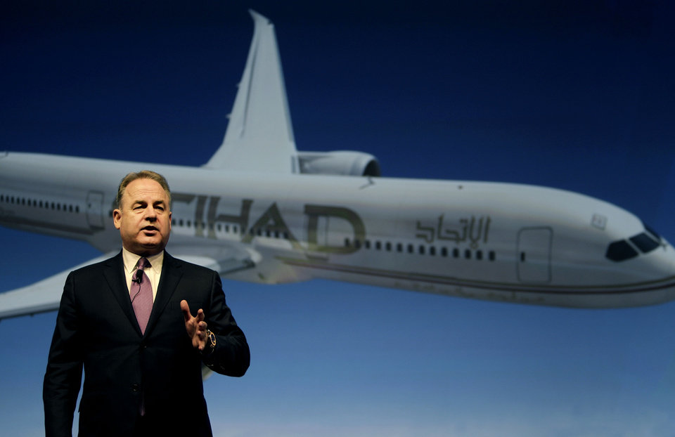 Photo - Etihad Chief Executive James Hogan, speaks during a press conference in Abu Dhabi, United Arab Emirates, Sunday, May 4, 2014. Etihad Airways, a fast-growing Mideast carrier, laid out plans Sunday to offer passengers who find first-class seats a bit too tight a miniature suite featuring a closed-off bedroom, private bathroom and a dedicated butler. Hogan conceded that offering what the airline says is the first-of-its kind multi-room suite helps generate buzz, but that ultimately it is a serious effort to bring in more cash. (AP Photo/Kamran Jebreili)