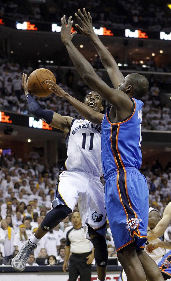 Photo - Memphis Grizzlies guard Mike Conley (11) drives against Oklahoma City Thunder center Nazr Mohammed, right, during the second half of Game 6 of a second-round NBA basketball playoff series on Friday, May 13, 2011, in Memphis, Tenn. (AP Photo/Lance Murphey)