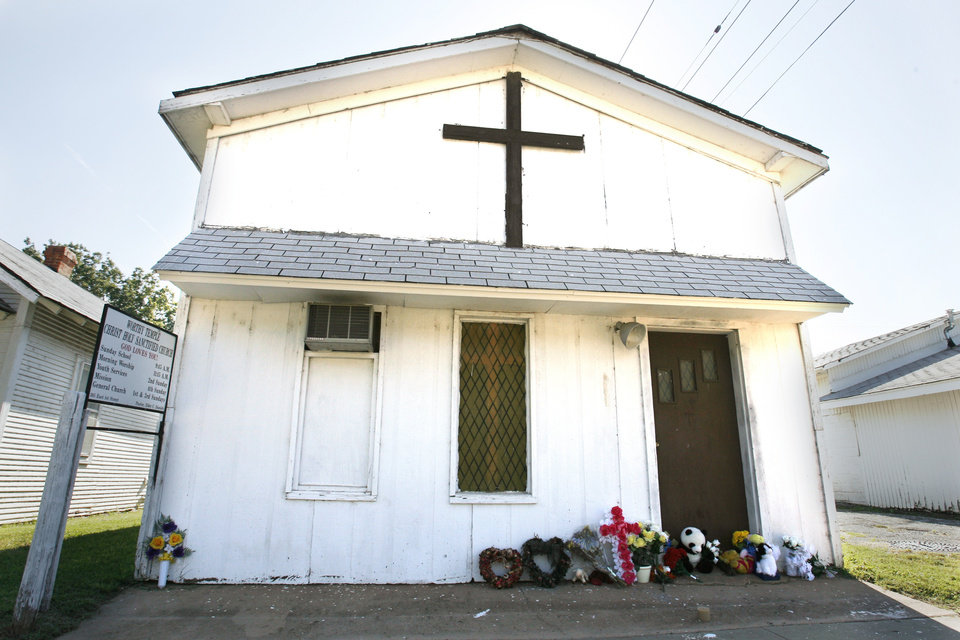 Photo - Flowers, stuffed animals and mementos are seen in this August photo at the entrance to the church where the Rev. Carol Daniels was killed in Anadarko. PHOTO By Steve Sisney, OKLAHOMAN ARCHIVE