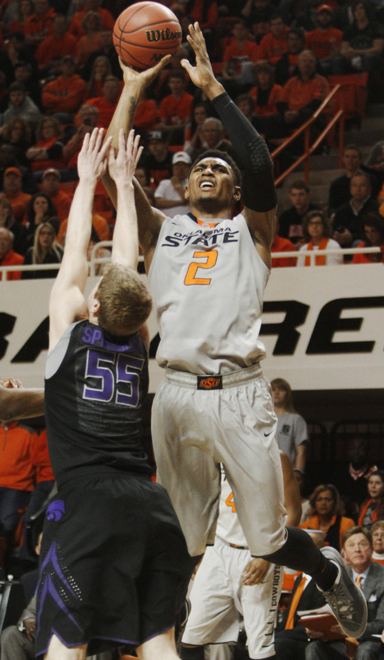Photo - Oklahoma State's Le'Bryan Nash (2) shoots a jump shot over Kansas State defender Will Spradling (55) in an NCAA college basketball game in Stillwater, Okla., Monday, March 3, 2014. Oklahoma State won 77-61. (AP Photo/The Oklahoman, KT King)