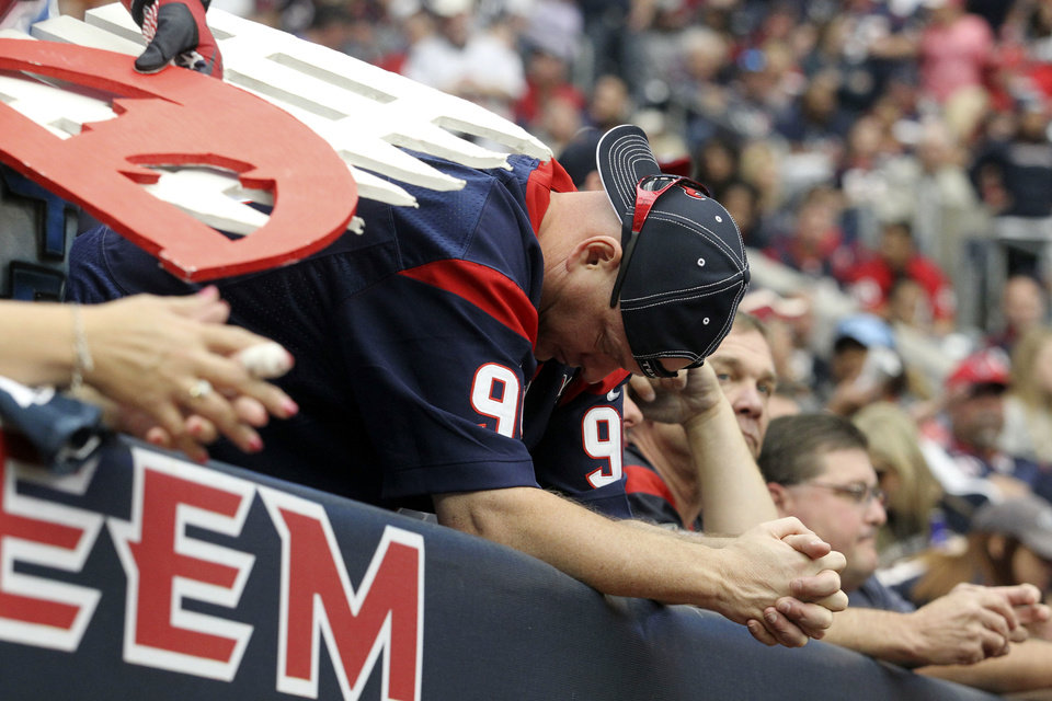 Photo -   A Houston Texans fan hangs his head during the fourth quarter of an NFL football game against the Jacksonville Jaguars, Sunday, Nov. 18, 2012, in Houston. (AP Photo/Patric Schneider)
