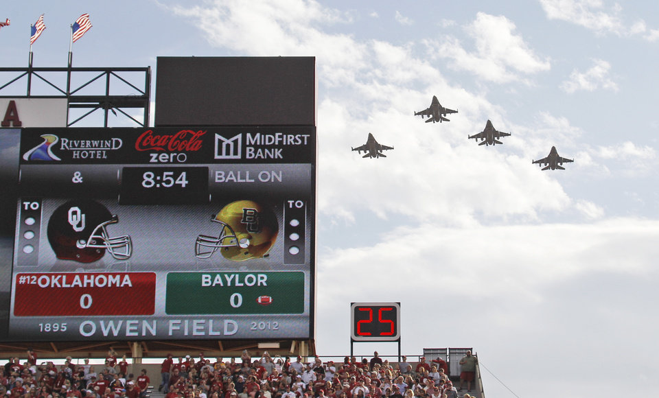 Photo -   F-16s from the 93rd Fighter Squadron from the Homestead Air Reserve Base in Miami, Fla., fly over Gaylord Family-Oklahoma Memorial Stadium before the Baylor against Oklahoma NCAA college football game in Norman, Okla., Saturday, Nov. 10, 2012. (AP Photo/Sue Ogrocki)