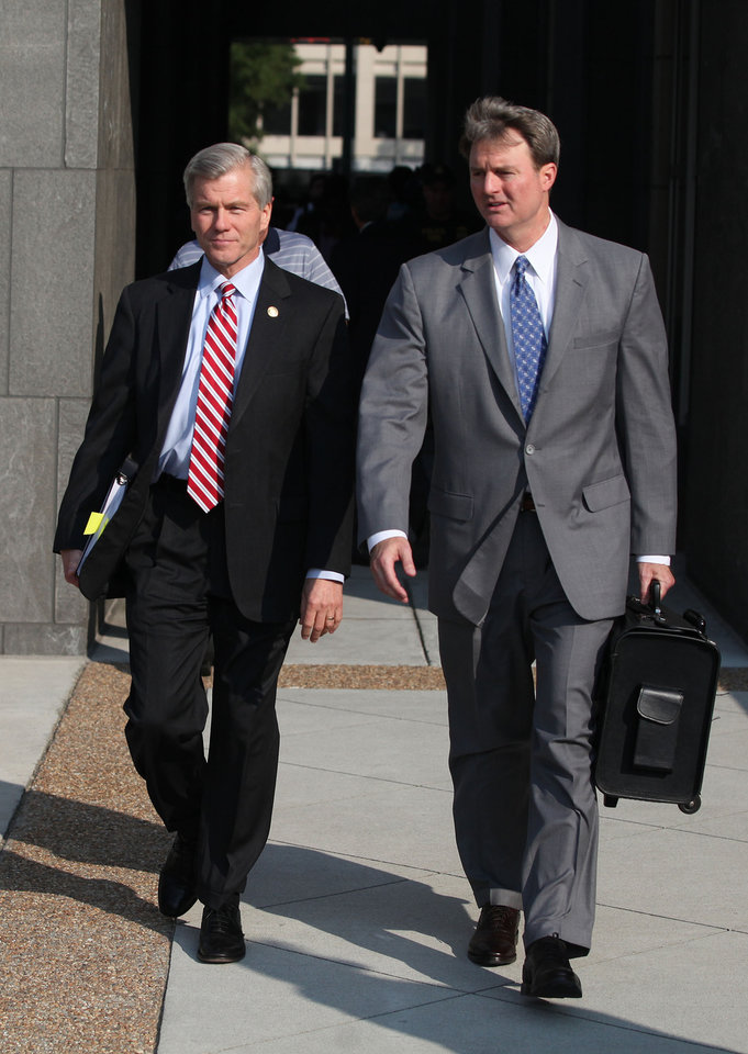 Photo - Former Virginia Gov. Bob McDonnell, center left, leaves the federal courthouse in Richmond after testifying on the third day of the former Governor and his wife Maureen's corruption trial, Wednesday, July 30, 2014 in Richmond, Va. (AP Photo/Richmond Times-Dispatch, Daniel Sangjib Min)