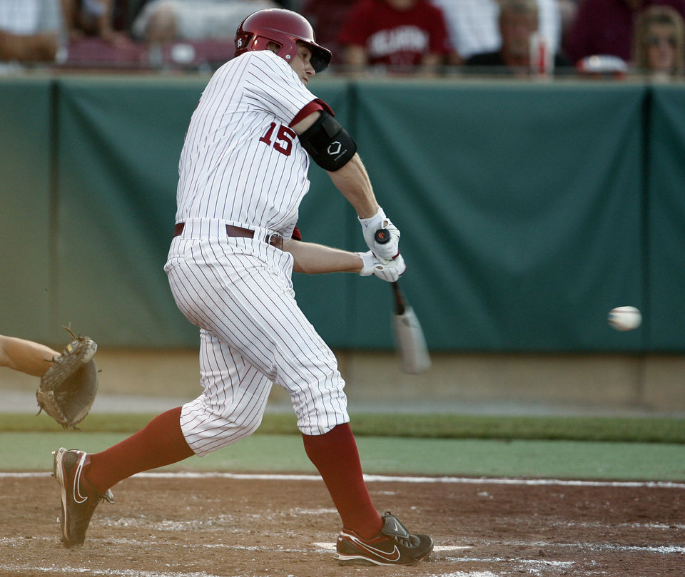 Photo - Aaron Baker hits a home run in early innings as the University of Oklahoma plays Wichita State at L. Dale Mitchell Park in the NCAA Regional baseball tournament in Norman, Okla. on Friday, May 29, 2009. 