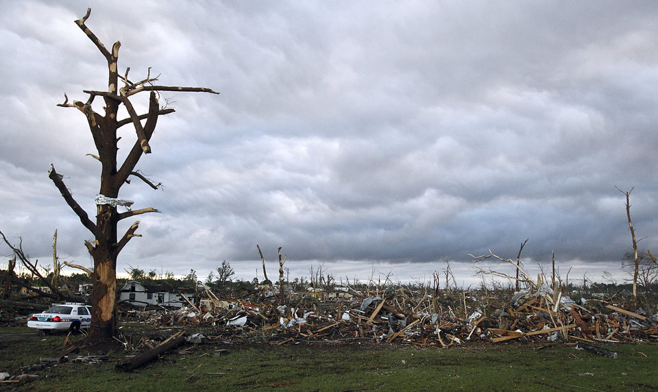 Photo - Devastation is left Thursday, April 28, 2011 after a tornado hit Pleasant Grove, Ala., just west of downtown Birmingham Wednesday afternoon.   (AP Photo/Butch Dill)