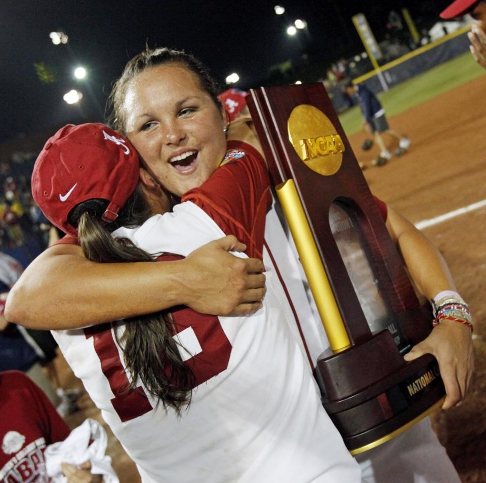 UNIVERSITY OF OKLAHOMA / COLLEGE SOFTBALL: Alabama\'s Jackie Traina (33) hugs Cassie Reilly-Boccia (18) as she holds the national championship trophy after Game 3 of the Women\'s College World Series softball championship between OU and Alabama at ASA Hall of Fame Stadium in Oklahoma City, Wednesday, June 6, 2012. Alabama won, 5-4. Photo by Nate Billings, The Oklahoman