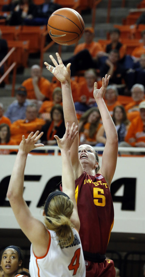 Photo - Iowa State's Hallie Christofferson (5) shoots over Oklahoma State's Liz Donohoe (4) during the women's college basketball game between Oklahoma State and Iowa State at  Gallagher-Iba Arena in Stillwater, Okla.,  Sunday,Jan. 20, 2013. Photo by Sarah Phipps, The Oklahoman