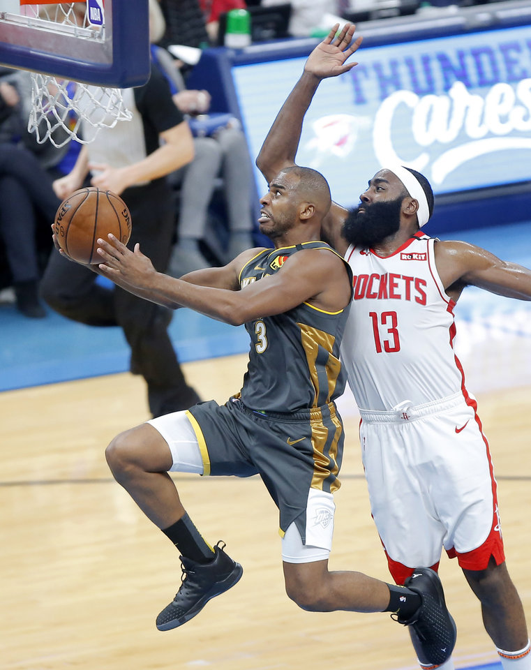 Photo - Oklahoma City's Chris Paul (3) goes to the basket past Houston's James Harden (13) during an NBA basketball game between the Oklahoma City Thunder and Houston Rockets at Chesapeake Energy Arena in Oklahoma City, Thursday, Jan. 9, 2020. [Bryan Terry/The Oklahoman]