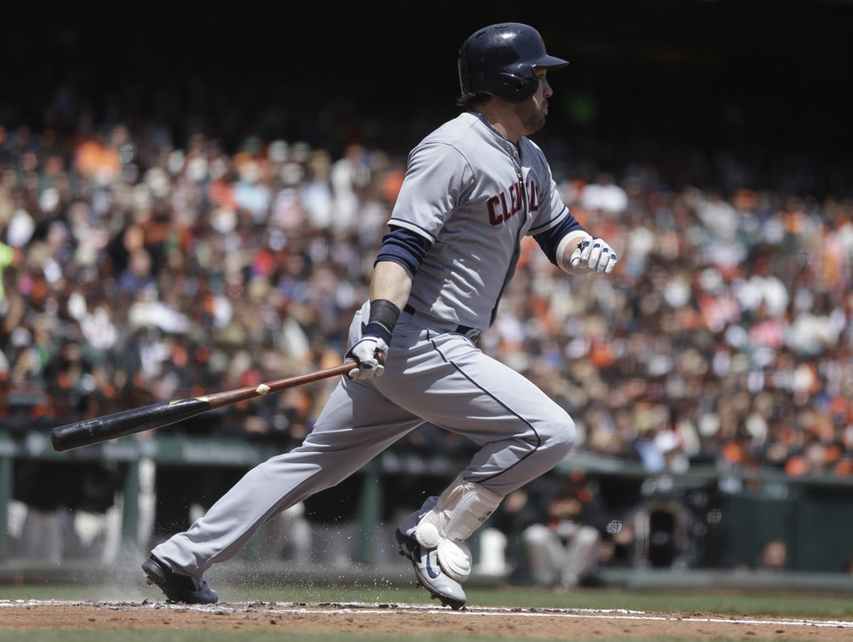 Photo - Cleveland Indians' Jason Kipnis swings for an RBI-single off San Francisco Giants' Tim Lincecum in the first inning of a baseball game on Saturday, April 26, 2014, in San Francisco. (AP Photo/Ben Margot)