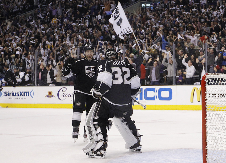 Photo - Los Angeles Kings' Drew Doughty, left, and goalie Jonathan Quick celebrate their team's 2-1 win against the St. Louis Blues in Game 6 of a first-round NHL hockey Stanley Cup playoff series in Los Angeles, Friday, May 10, 2013. (AP Photo/Jae C. Hong)