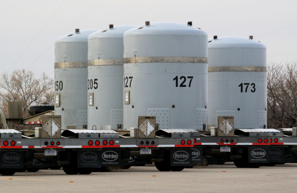 Photo -  Empty nuclear waste shipping containers sit in front of the Waste Isolation Pilot Plant March 6 near Carlsbad, N.M. AP Photo   Susan Montoya Bryan -  AP