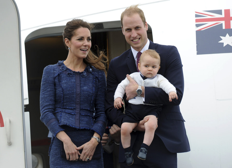 Photo -  Britain's Prince William carries Prince George with Catherine, Duchess of Cambridge as they depart on an RAAF plane bound for Sydney, Wellington, New Zealand, Wednesday, April 16, 2014.  (AP Photo/SNPA, Ross Setford) **NEW ZEALAND OUT***