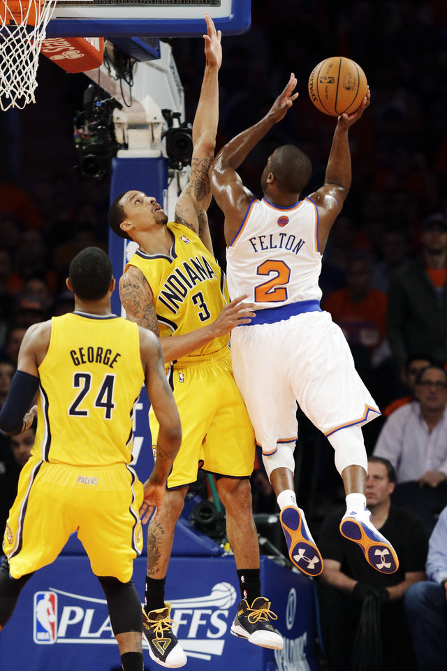 Photo - New York Knicks' Raymond Felton (2) is guarded by Indiana Pacers' George Hill as he drives to the basket in the first quarter of Game 1 of their NBA basketball playoff series in the Eastern Conference semifinals at Madison Square Garden in New York, Sunday, May 5, 2013. (AP Photo/Kathy Willens)