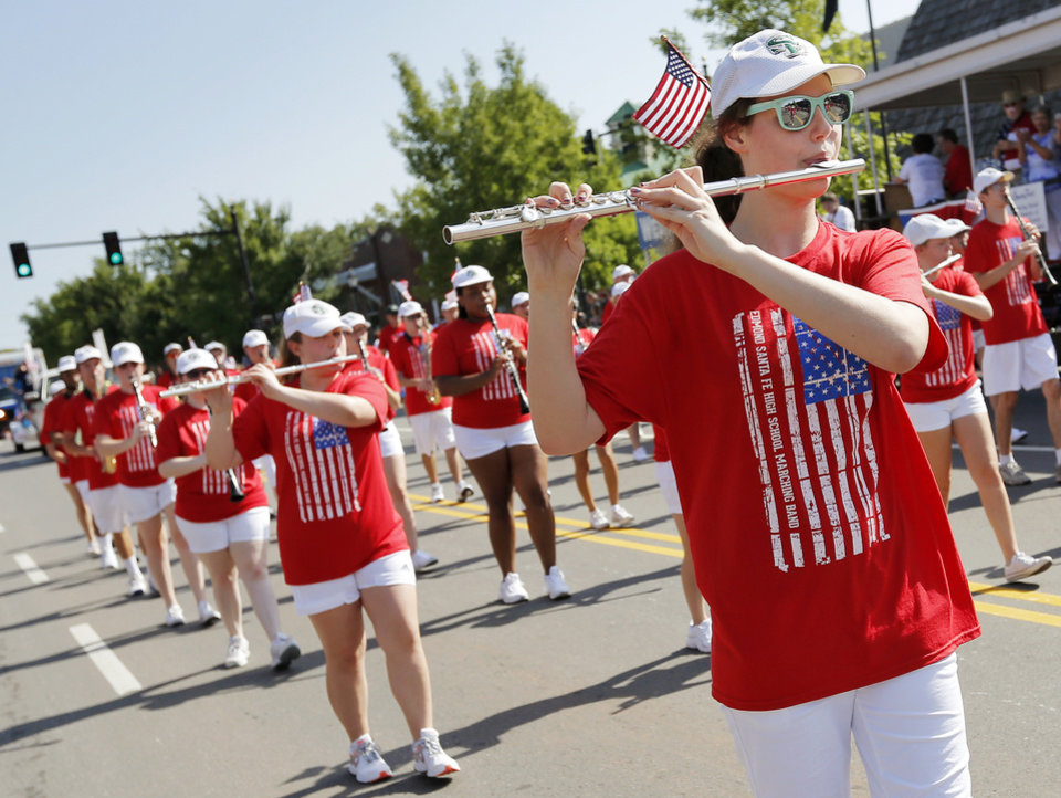 Photo - The Edmond Santa Fe Marching Band plays during the Edmond LibertyFest Parade in downtown Edmond, Okla., on Independence Day, Friday, July 4, 2014. Photo by Nate Billings, The Oklahoman