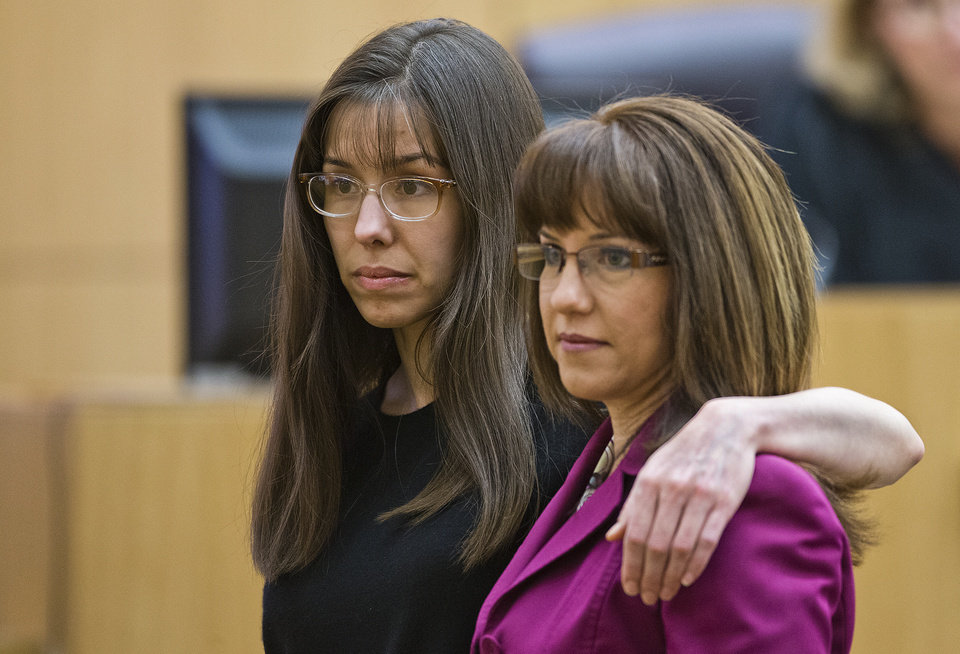 Photo - Jodi Arias, left,  demonstrates how she had her arm around her sister in a photograph that had been admitted into evidence  Monday March 4, 2013 in Phoenix.  She put her arm around defense attorney Jennifer Willmott during redirect from defense attorney Kirk Nurmi.   Arias is on trial for the murder of Travis Alexander in 2008.  (AP Photo/The Arizona Republic, Tom Tingle, POOL )