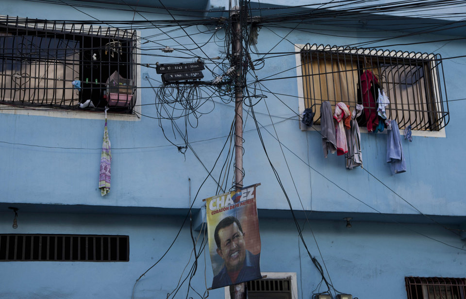 A poster with an image of  Venezuela President Hugo Chavez hangs from an electric pole in Caracas, Venezuela, Thursday, Jan. 3, 2013. The ailing president's health crisis has raised contentious questions ahead of the swearing-in set for Jan. 10, including whether the inauguration could legally be postponed. Officials have raised the possibility that Chavez might not be well enough to take the oath of office, without saying what will happen if he can't. The constitution says that if a president or president-elect dies or is declared unable to continue in office, presidential powers should be held temporarily by the president of the National Assembly and that a new presidential vote should be held within 30 days. (AP Photo/Ariana Cubillos)