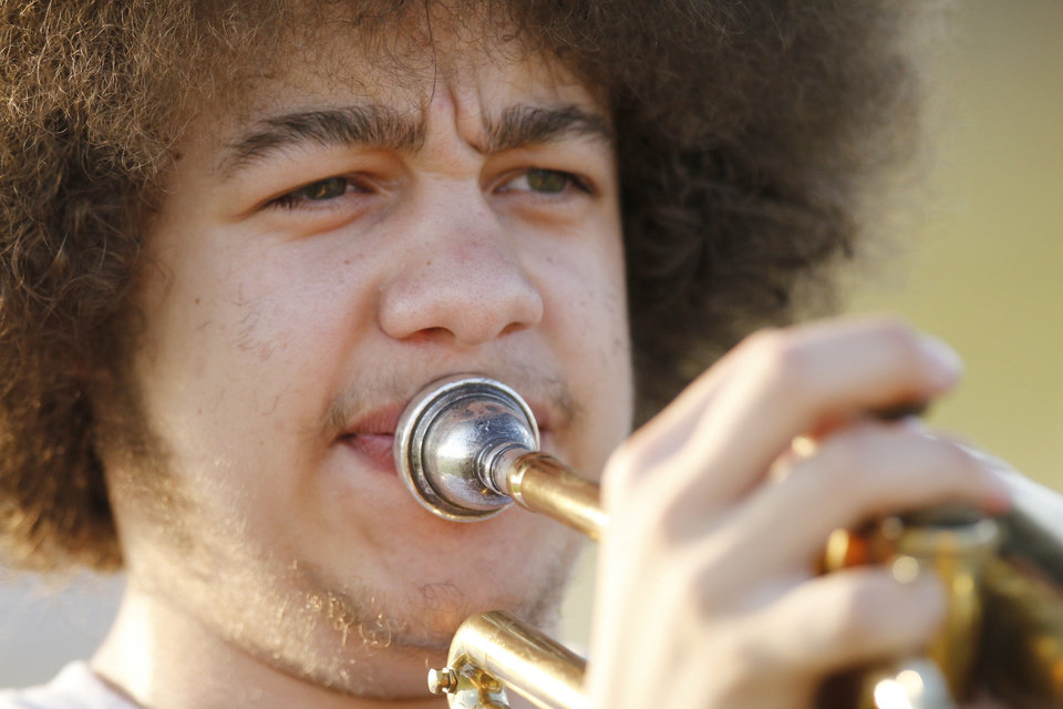 Photo - Christopher Braxton plays during pre game. The Star Spencer band performs during the pregame at the high school football game between Millwood and Star Spencer in Spencer, Thursday, September 5, 2013. Photo by Doug Hoke, The Oklahoman