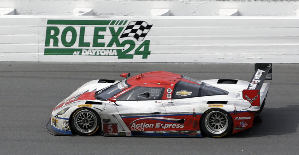 Photo - Sebastian Bourdais, of France, drives the Action Express Racing Corvette DP through the front stretch during the IMSA Series Rolex 24 hour auto race at Daytona International Speedway in Daytona Beach, Fla., Sunday, Jan. 26, 2014.(AP Photo/John Raoux)