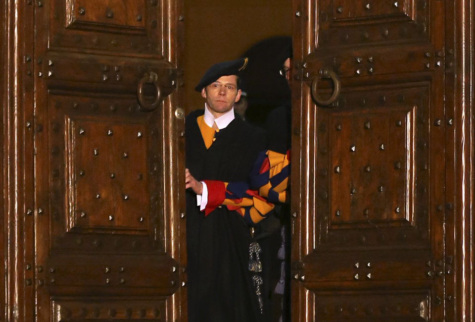Photo - Vatican Swiss guards close the main door of the papal residence in Castel Gandolfo, south of Rome, Thursday, Feb. 28, 2013. Benedict XVI greeted the faithful for the last time as pope on Thursday, telling tearful well-wishers that he is beginning the final stage of his life as
