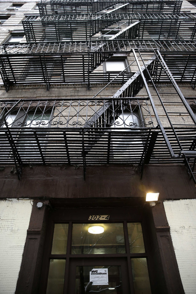 Photo - An apartment building at 320 Mott St. is seen in New York, Wednesday, Feb. 5, 2014. Four people are in custody on drug charges after police executed search warrants at three apartments in the building. (AP Photo/Seth Wenig)