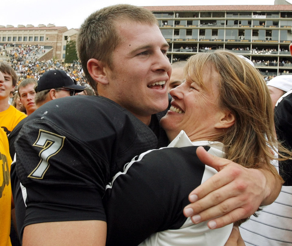 Photo - Colorado quarterback Cody Hawkins (7) hugs his mother, Misti Hawkins, after the college football game between the University of Oklahoma Sooners (OU) and the University of Colorado Buffaloes (CU) at Folsom Field in Boulder, Co., on Saturday, Sept. 28, 2007. Colorado won, 27-24. By NATE BILLINGS, The Oklahoman
