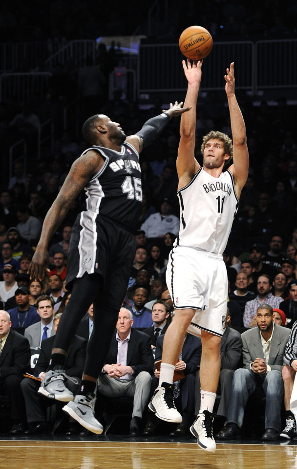 Brooklyn Nets\' Brook Lopez (11) shoots over San Antonio Spurs\' DeJuan Blair (45) in the first half of an NBA basketball game, Sunday, Feb. 10, 2013, at Barclays Center in New York. (AP Photo/Kathy Kmonicek)