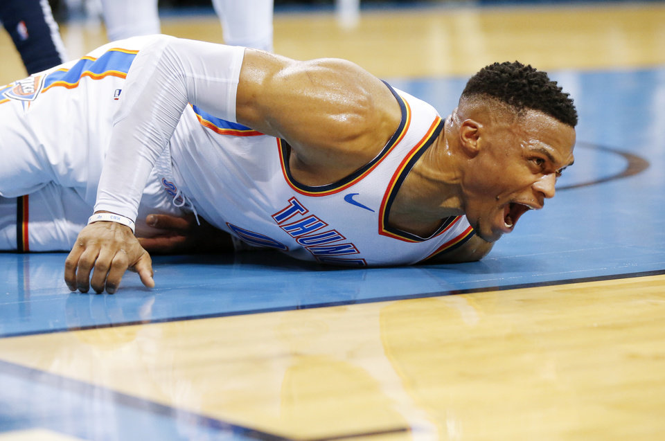 Photo -  Oklahoma City's Russell Westbrook yells after being injured in the third quarter of Monday's game with the New Orleans Pelicans at Chesapeake Energy Arena. Oklahoma City won 122-116. [Photo by Nate Billings, The Oklahoman]