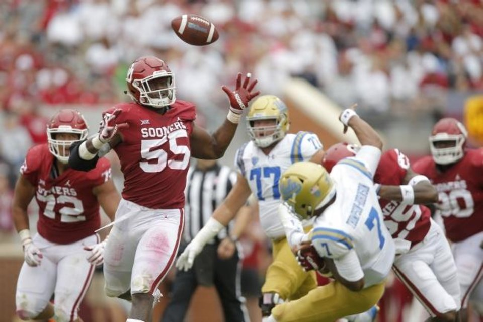 Photo -  Kenneth Mann (55), Justin Broiles (25) and the Oklahoma defense battered quarterback Dorian Thompson-Robinson (7) and UCLA in a 49-21 rout last season in Norman. The Sooners will head to California this season to face the Bruins. [Bryan Terry/The Oklahoman]