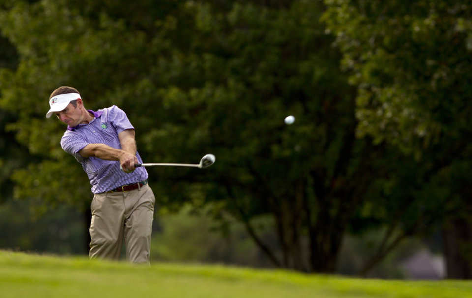 Photo - Bill Williamson plays his second shot at the 16th hole during the semifinal round of match play at the U.S. Mid-Amateur Championship golf tournament at the Country Club of Birmingham in Birmingham, Ala., Wednesday, Oct. 9, 2013. (AP Photo/USGA, Steve Gibbons)