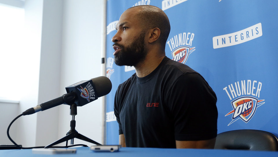 Photo - Derek Fisher speaks during exit interviews with the media for the Oklahoma City Thunder at the team's practice facility in Oklahoma City, Sunday, June 1, 2014. The Photo by Nate Billings, The Oklahoman