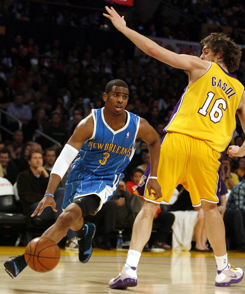 Photo - New Orleans Hornets' Chris Paul, left, drives around Los Angeles Lakers' Pau Gasol, of Spain, during the first half of an NBA basketball game in Los Angeles on Tuesday, Jan. 6, 2009. (AP Photo/Danny Moloshok) ORG XMIT: LAS107