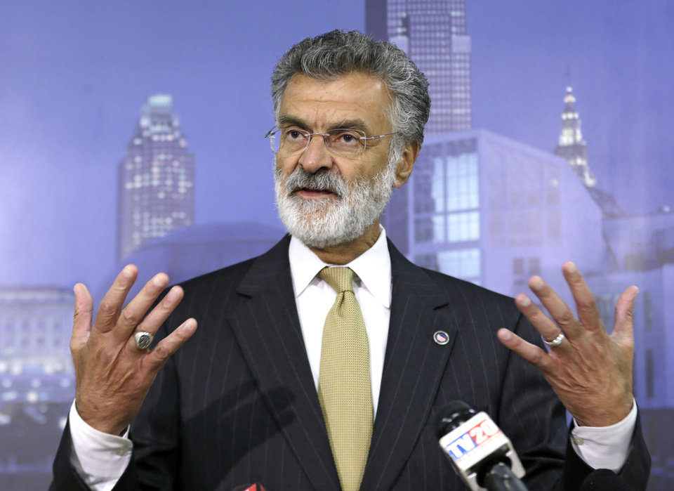 Photo - Cleveland Mayor Frank Jackson answers questions Tuesday, Oct. 15, 2013 about the disciplinary results for Cleveland police officers involved in a deadly police chase in 2012 in Cleveland. Cleveland Police Chief Michael McGrath says 63 officers have been suspended for breaking rules during a deadly chase last November. Timothy Russell and Malissa Williams were killed after police opened fire on their car, firing 137 shots. (AP Photo/Tony Dejak)